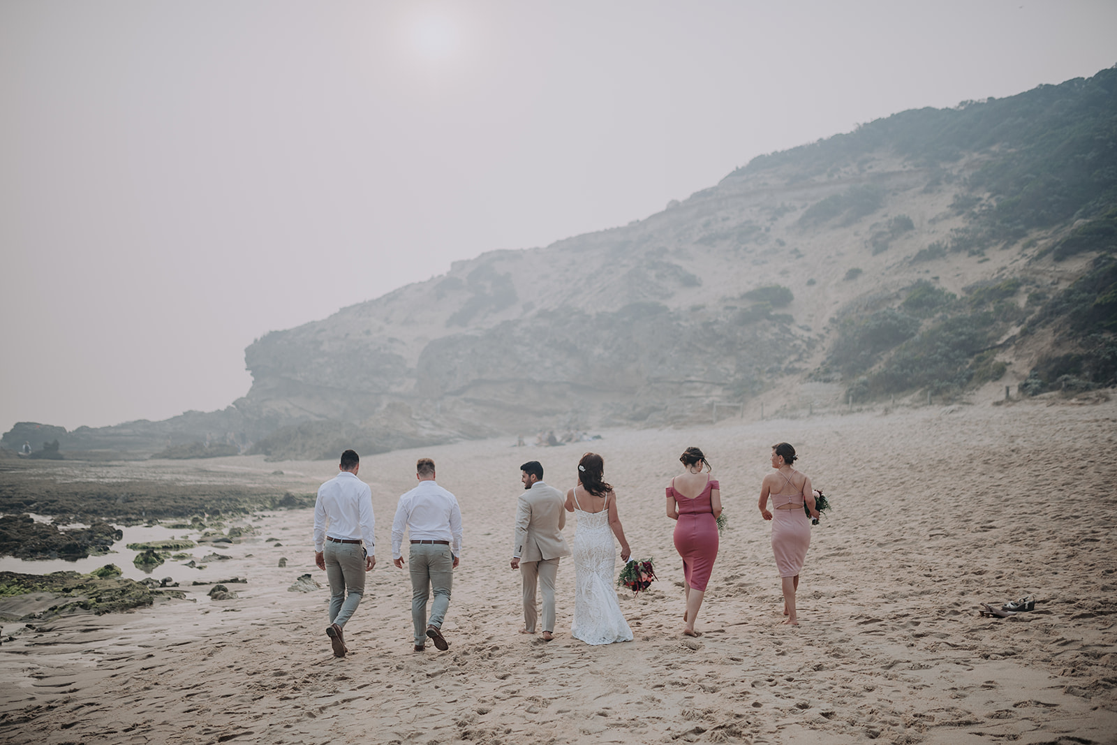 Wedding Party Walking On Beach